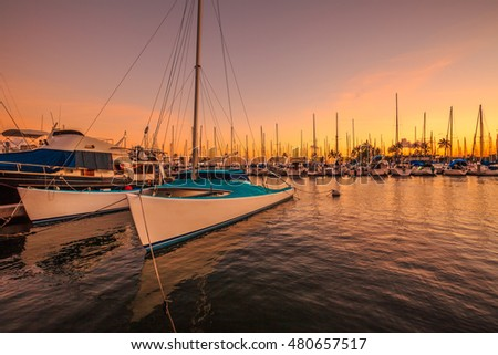 Fishing boats docked at the Ala Wai Harbor at sunset. Ala Wai Yacht Harbor is the largest yacht harbor of Hawaii, situated between Waikiki and downtown Honolulu.