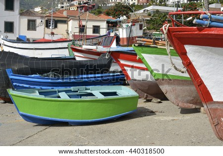 Fishing boats drawn up on beach and slipway at Camara de Lobos in Madeira, Portugal
