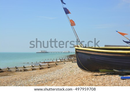 Fishing boats drawn up on the beach a Worthing, West Sussex, England