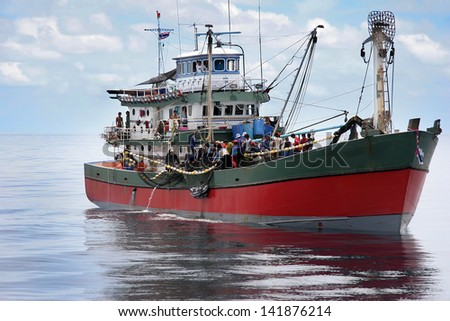 Fishing boats, fishermen are catching fish. - stock photo