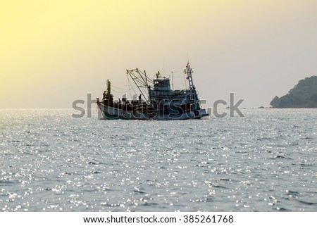 Fishing boats floating in the sea with beautiful sunlight background.