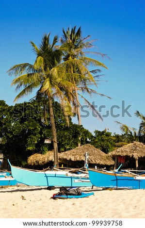 Fishing boats for rent in a small coastal village in pagudpud, philippines - stock photo