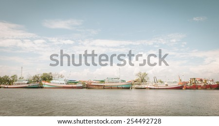 Fishing Boats in a Harbor with retro tone - stock photo