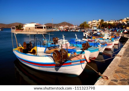 Fishing boats in Elounda (Crete, Greece). Elounda is a small fishing town on the northern coast of the island of Crete, Greece. - stock photo