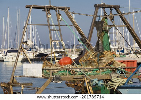 fishing boats in harbor - fishing nets