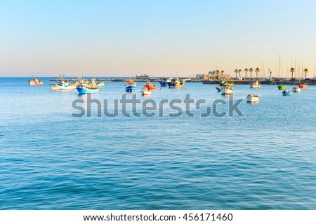 Fishing boats in ocean marina at sunset. Portugal - stock photo