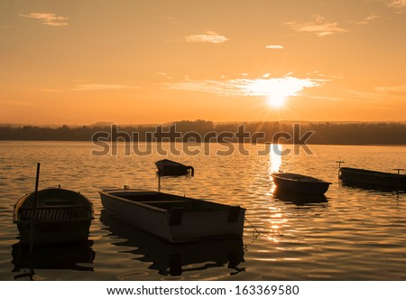 Fishing boats in sunset