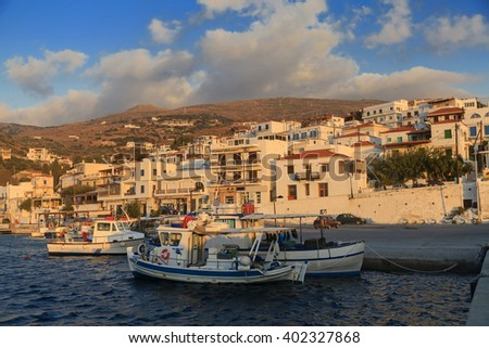Fishing boats in the bay of greek village at sunrise - stock photo