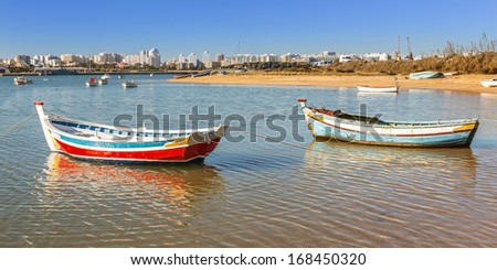 Fishing boats in the bay of the village of Ferragudo. Portugal. - stock photo