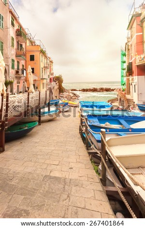 Fishing boats in the coastal town of Riomaggiore in the Cinque Terre National Park, Italy. - stock photo