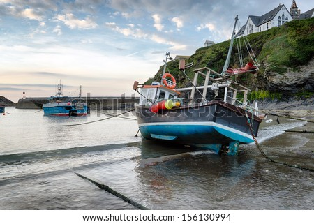 Fishing boats in the harbour at Port Isaac an historic fishing village on the north coast of Cornwall - stock photo
