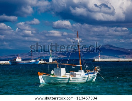 Fishing boats in the marine bay on the island of Mykonos in Greece.... - stock photo