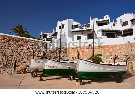 Fishing boats in traditional white village of Binibequer Vell, Menorca, Balearic Islands, Spain - stock photo