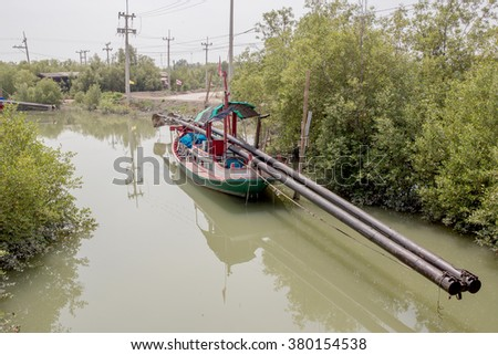 fishing boats line up on the river banks after returning from sea. - stock photo