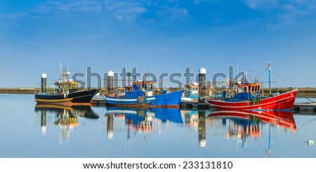 Fishing boats moored at the dock. Industrial ships. Portugal. - stock photo