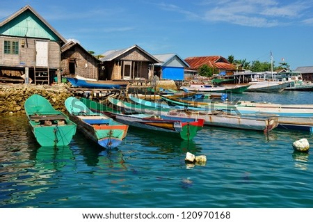 Fishing boats moored up outside Bajo village, Sulawesi, Indonesia