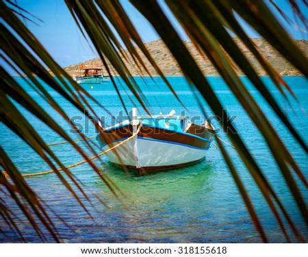 Fishing Boats off the coast of Crete, Mirabello Bay,Greece - stock photo