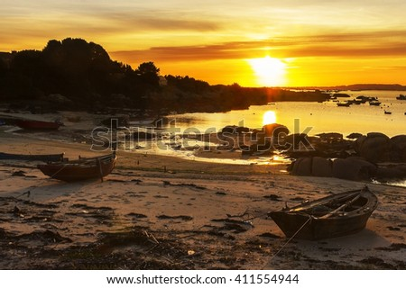 Fishing boats on Abilleira beach, Arousa Island, at sunset