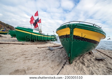 Fishing boats on Baltic Sea beach in Karlikowo District in Sopot, Poland