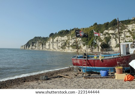 Fishing boats on beach at Beer in South Devon - stock photo