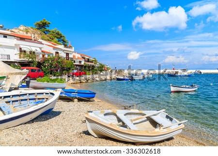 Fishing boats on beach in Kokkari village, Samos island, Greece - stock photo