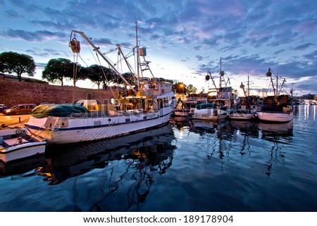 Fishing boats on colorful sunset in Zadar, Croatia - stock photo