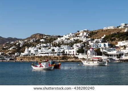 Fishing boats on Mykonos island cityscape background - stock photo