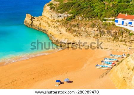 Fishing boats on sandy Benagil beach in Algarve region, Portugal - stock photo