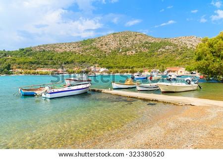 Fishing boats on sea water in Posidonio bay, Samos island, Greece - stock photo