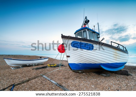 Fishing boats on the beach at Dungeness in Kent - stock photo