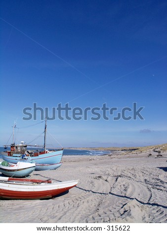 Fishing boats on the beach at Vorupore in western Jutland, Denmark.