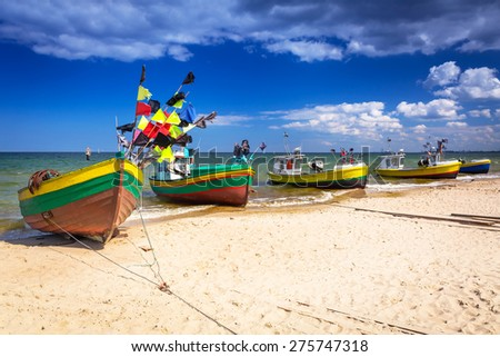 Fishing boats on the beach of Baltic Sea in Poland - stock photo