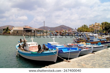 Fishing boats on the moorage in port in of Heraklion, Crete Greece - stock photo