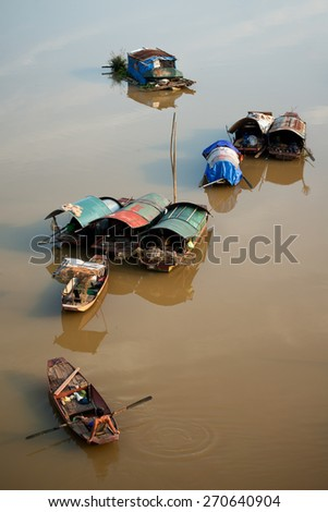 Fishing boats on the Red River, Hanoi, Vietnam - stock photo