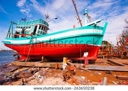 Fishing boats on the shore - stock photo