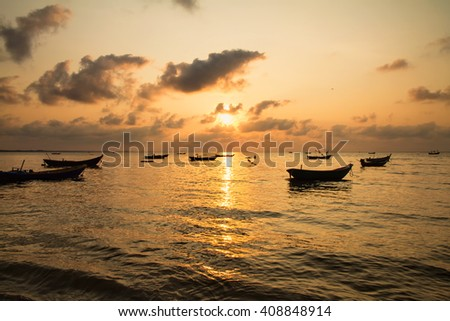 Fishing boats, small boats floating in the sea at sunrise, Concept sea in the morning.