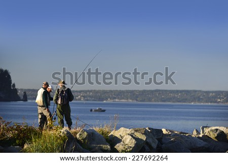 Fishing by English Bay in Vancouver, British Columbia, Canada - stock photo