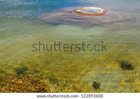 Fishing Cone geyser in Yellowstone Lake - stock photo