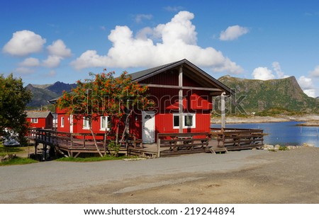Fishing cottages by the sea. Lofoten, Norway. - stock photo