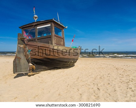 Fishing cutter on a beach at the Island of Usedom, Germany