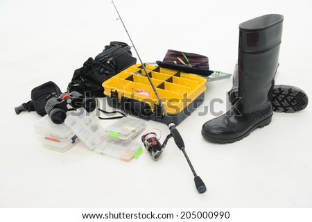 Fishing equipment box for hooks and flies hat, spinner, waders and binoculars. Isolated on white background - stock photo