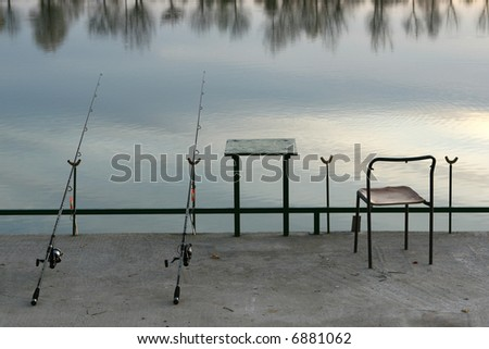 Fishing equipment on the lake - stock photo