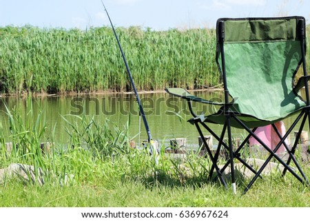 Fishing equipment with a chair by the lake
