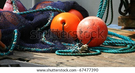 Fishing floats on deck of a commercial fishing boat in an oregon Harbor - stock photo