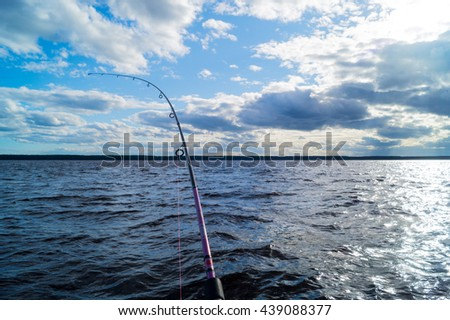 fishing from a boat, Trolling fishing boat rod, sky scenery above the water