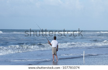Fishing from the beach in Outer Banks North Carolina - stock photo