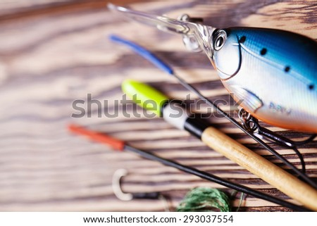 Fishing gear closeup with blur effect - stock photo