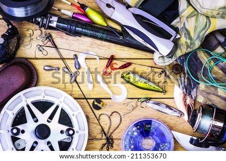 Fishing gear on the table as a frame - stock photo