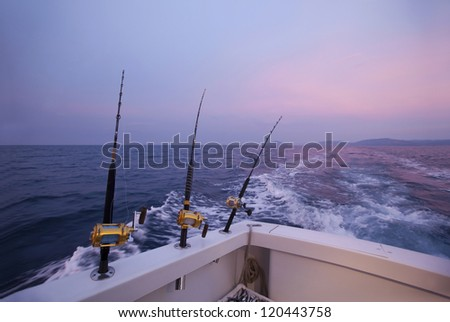 Fishing gears and fisherman boat sailing away in open sea