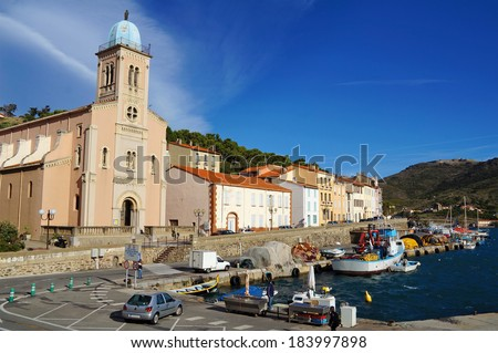 Fishing harbor and church of Port Vendres in the Pyrenees Orientales, Mediterranean sea, Roussillon, Cote Vermeille, France - stock photo